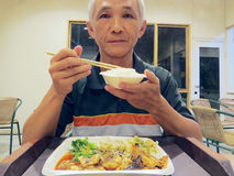 Man eating buffet stock image