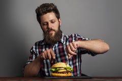 Man eating burger Royalty Free Stock Photo