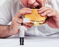 Man eating burger Royalty Free Stock Image