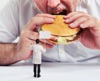 Man eating burger Royalty Free Stock Image
