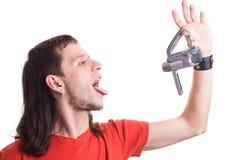 Man eating camera Royalty Free Stock Photo