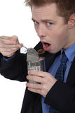 Man eating canned food Royalty Free Stock Image
