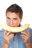 Man eating cantaloupe royalty free stock photography