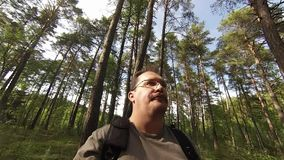 Man eating carrot in forest stock footage