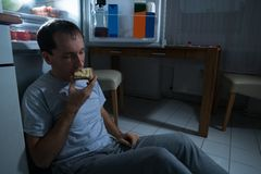 Man eating cheese bread. Portrait Of A Man Eating Cheese Bread At Home Royalty Free Stock Photography