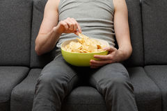 Man eating chips Royalty Free Stock Photography
