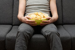 Man eating chips Royalty Free Stock Images