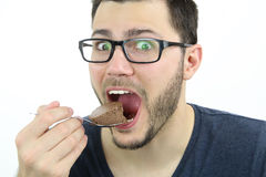 Man eating chocolate mousse Royalty Free Stock Images