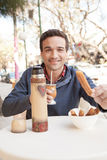 Man eating churro. Man eating a churro in Buenos Aires Royalty Free Stock Images