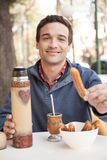 Man eating churro. Man eating a churro in Buenos Aires Stock Image