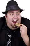 Man eating cookie Stock Images