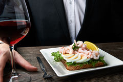 Man eating delicious shrimp salad sandwich Royalty Free Stock Photography