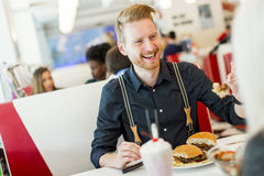 Man eating in the diner. Man eating at the table in the diner Royalty Free Stock Photos