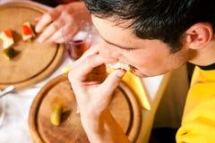 Man eating dinner Royalty Free Stock Photos