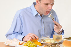 Man eating dinner Stock Photo