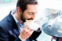 Man eating Doner Kebap. In bistro royalty free stock photography
