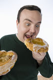 Man Eating Donut Royalty Free Stock Photos