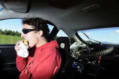 Man eating and driving Stock Photos
