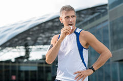 Man Eating Energy Bar Stock Image