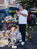 Man eating fast food outdoors at carnival Stock Images