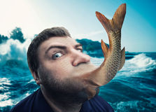 Man eating fish Stock Image