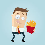Man eating french fries Stock Photography