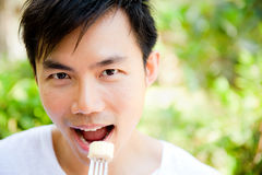 Man Eating Fruit Royalty Free Stock Image