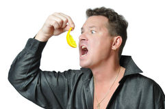 Man eating fruit royalty free stock images