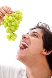 Man eating grapes Royalty Free Stock Photography