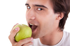 Man eating a green apple Stock Photo
