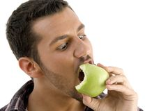 Man eating green apple Royalty Free Stock Photos