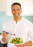 Man eating green salad Royalty Free Stock Photo