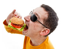 Man eating hamburger Stock Images