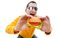 Man eating hamburger Royalty Free Stock Image