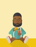 Man eating hamburger Stock Images