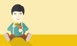 Man eating hamburger Stock Image