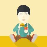 Man eating hamburger Royalty Free Stock Image