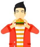 Man eating hamburger. Stock Photos