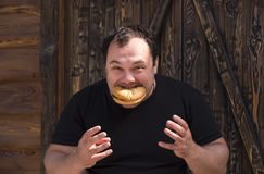 Man eating a hamburger Stock Images