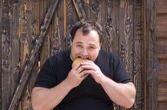 Man eating a hamburger Royalty Free Stock Image