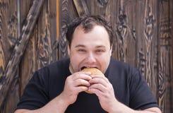Man eating a hamburger Royalty Free Stock Photo