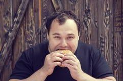 Man eating a hamburger Royalty Free Stock Images
