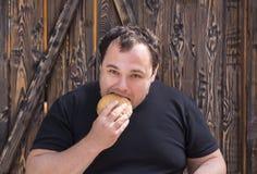 Man eating a hamburger Stock Photo