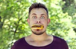 Man eating a hamburger Stock Images