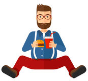 Man eating hamburger. A fat man with the beard sitting on the floor while eating hamburger and drinking soda vector flat design illustration isolated on white Royalty Free Stock Photo