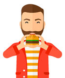 Man eating hamburger. A happy hipster man eating hamburger vector flat design illustration isolated on white background. Vertical layout Royalty Free Stock Photography