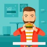 Man eating hamburger. Stock Photo