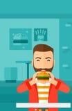 Man eating hamburger. Stock Images