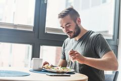 Man eating a healthy breakfast. Royalty Free Stock Photo