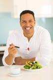 Man eating healthy food stock photos